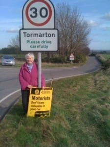 Cllr Sue Hope at the Tormarton village sign